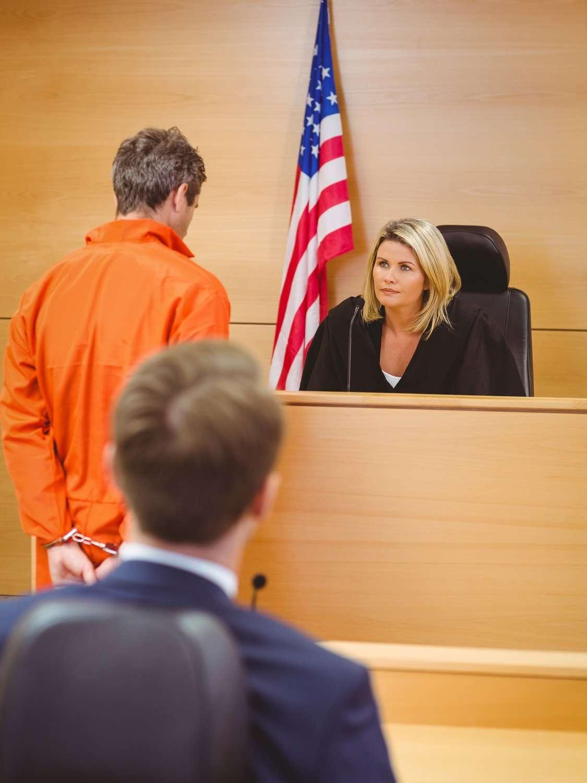 Drug crime lawyer defending criminal case in courtroom
