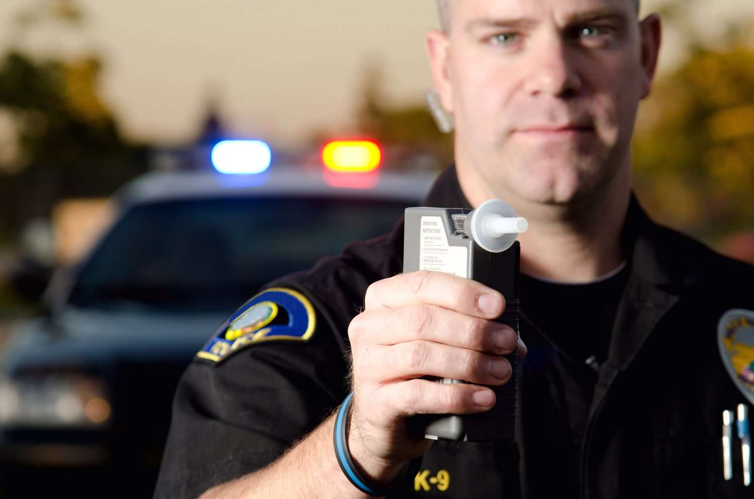 DUI: Police officer with breath test