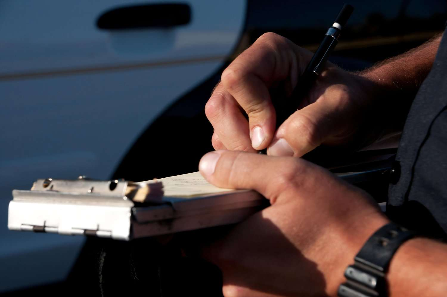 Traffic ticket lawyer: Police officer writes a traffic ticket